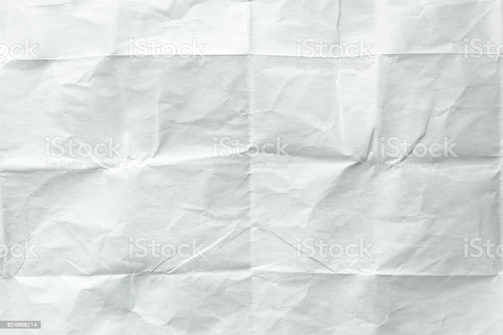 White sheet of paper folded. Crushed and folded white sheet of paper....