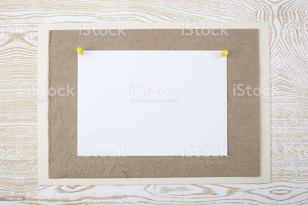White sheet on textured paper royalty-free stock photo