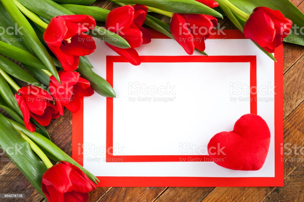 White Sheet With Plush Heart On Corner Two Red Frame And Red Tulips ...
