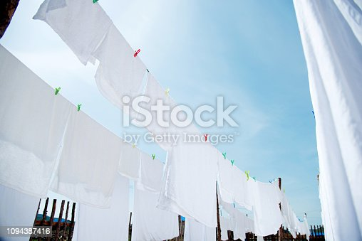 White sheets and towels hanging on clotheslines