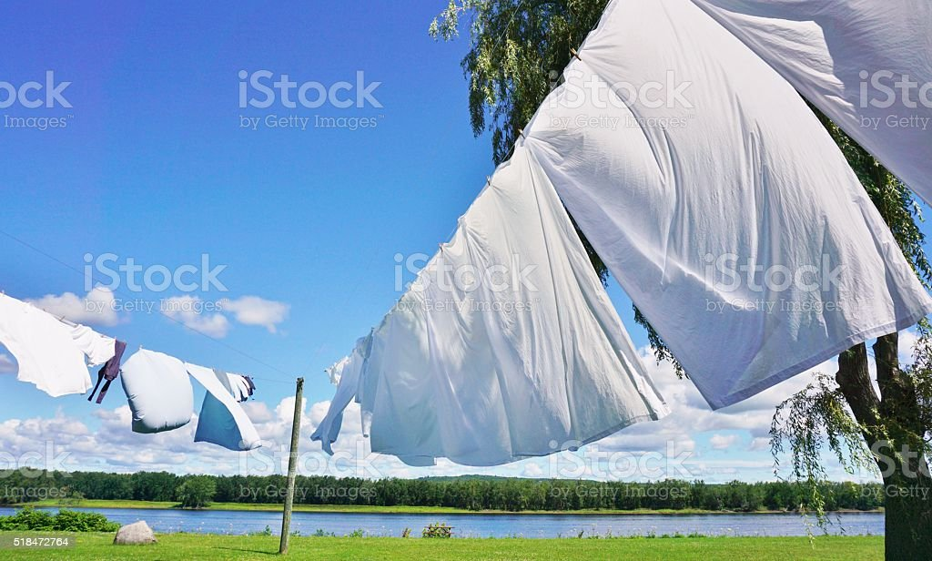 White Sheets Hanging on Clotheslines stock photo