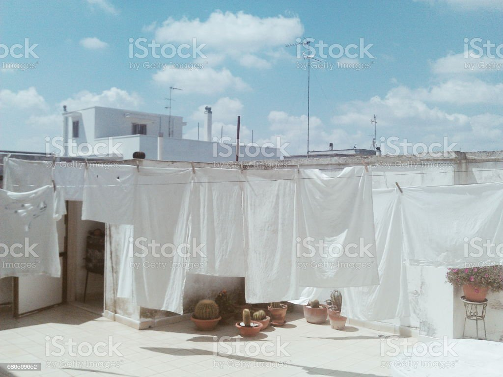 white sheets under the sun dry royalty-free stock photo