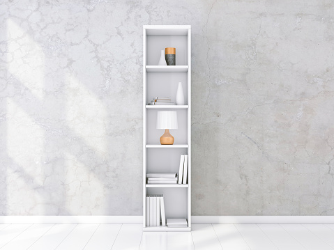 White shelving unit with books and decor in interior, concrete wall, bookshelf mockup
