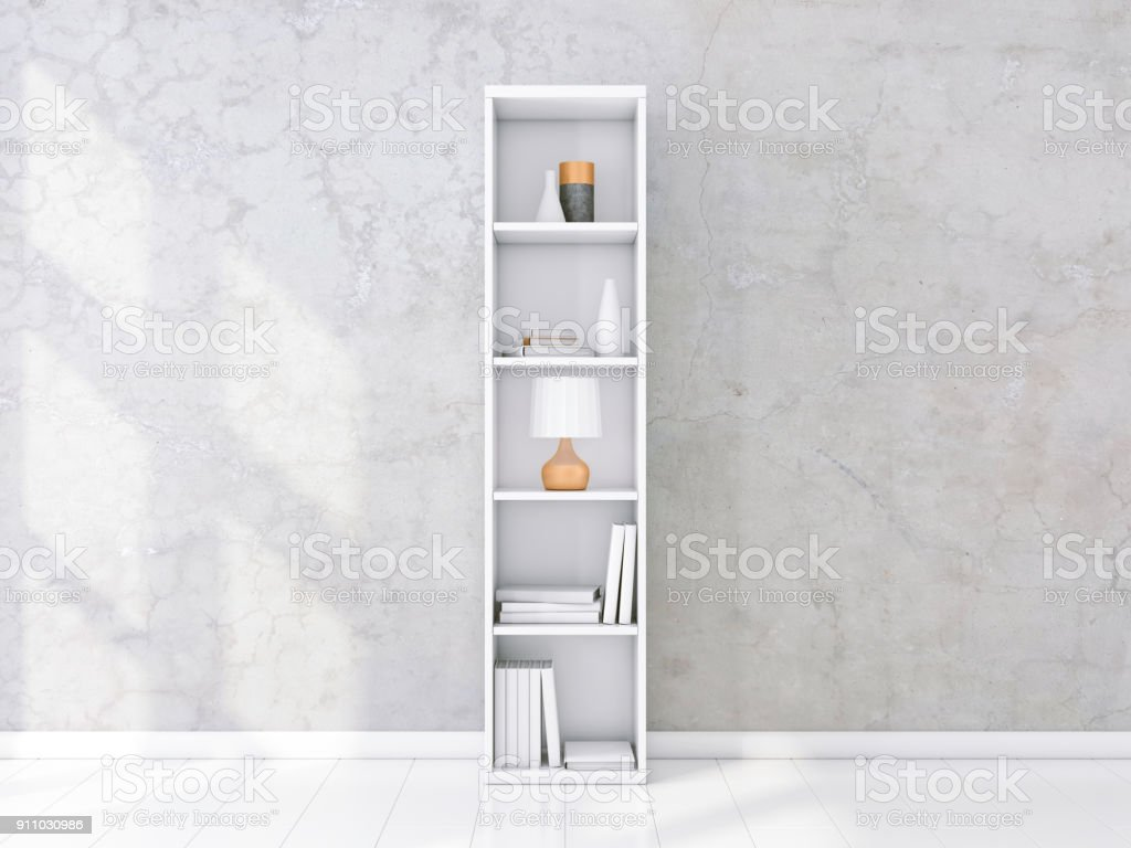 White shelving unit with books and decor in interior, concrete wall, bookshelf mockup stock photo