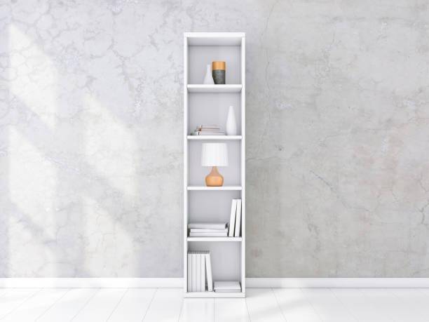書籍やインテリア、コンクリート壁、本棚のモックアップの装飾と白い棚ユニット ストックフォト