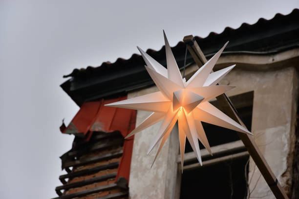 White shining star on wall of Harasov hotel ruine on 16th january in czech republic White shining star on wall of Harasov hotel ruine on 16th january in czech republic ruine stock pictures, royalty-free photos & images