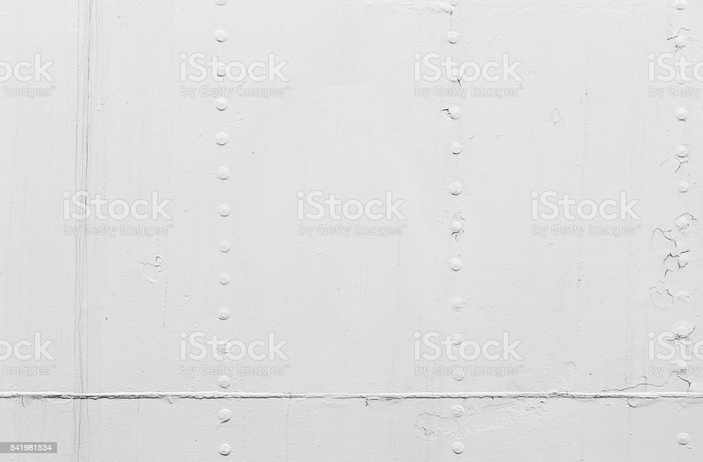 White ship hull, metal sheets with rivets stock photo
