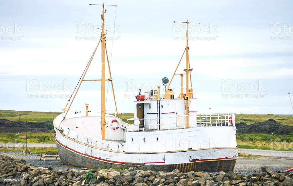 white ship in iceland harbour stock photo