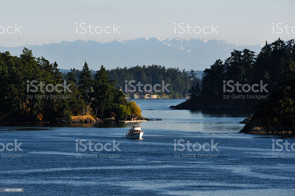 White ship, river and mountains stock photo