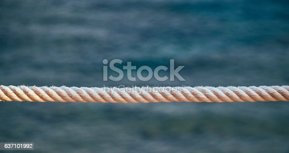 istock White ship rope and the sea 637101992