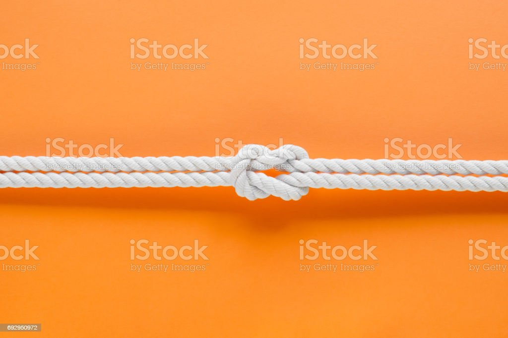 White ship ropes connected by reef knot stock photo