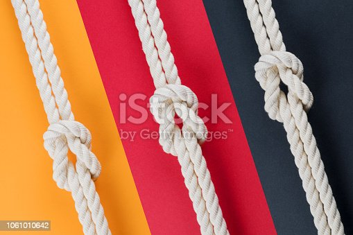 istock White ship ropes connected by reef knot set 1061010642
