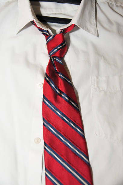White shirt with red striped necktie stock photo