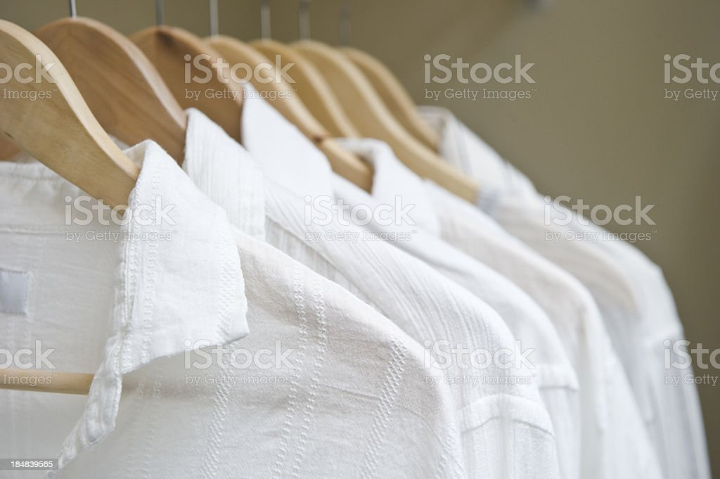 White Shirts in Closet A row of white shirts in a closet Boutique Stock Photo