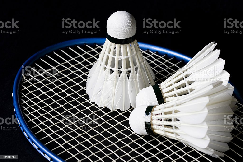 white shittlecock and badminton racket royalty-free stock photo
