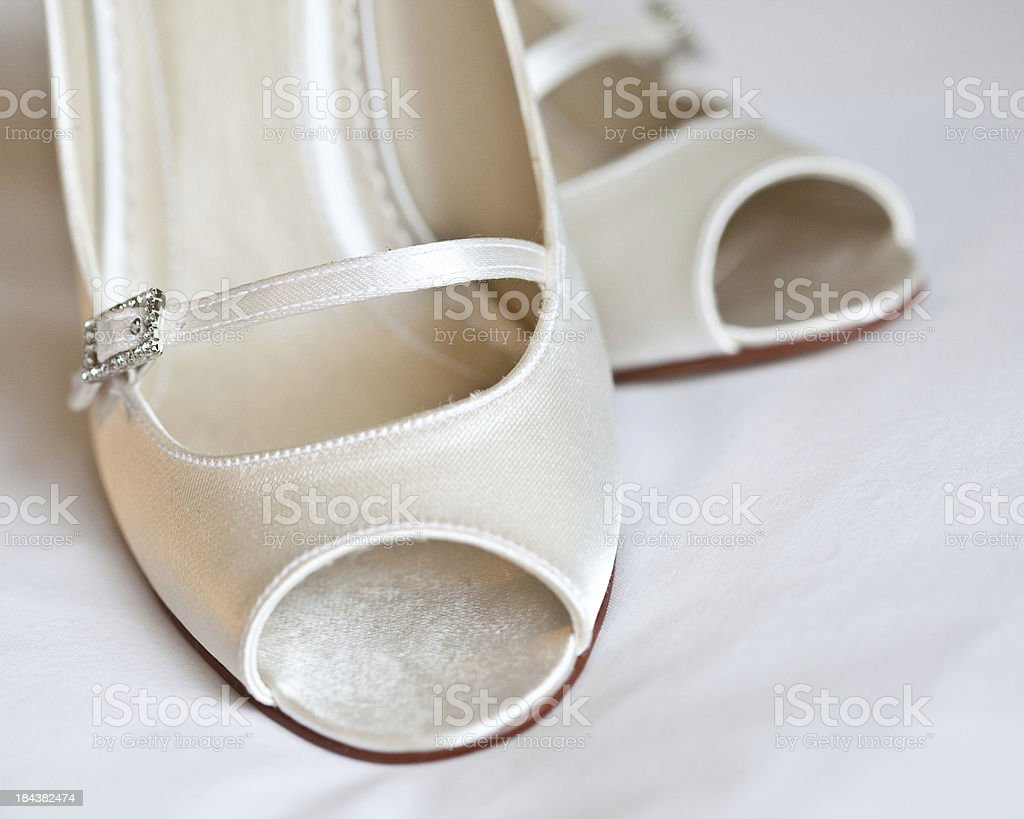 white shoes with silver diamanté buckle stock photo