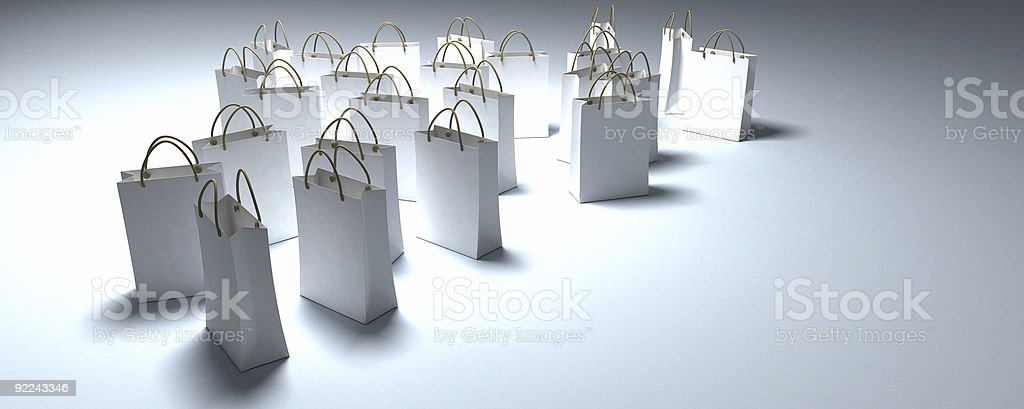 White shopping bags in a pool of light royalty-free stock photo