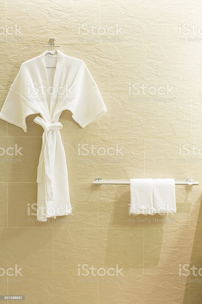 White shower gown and small towels stock photo