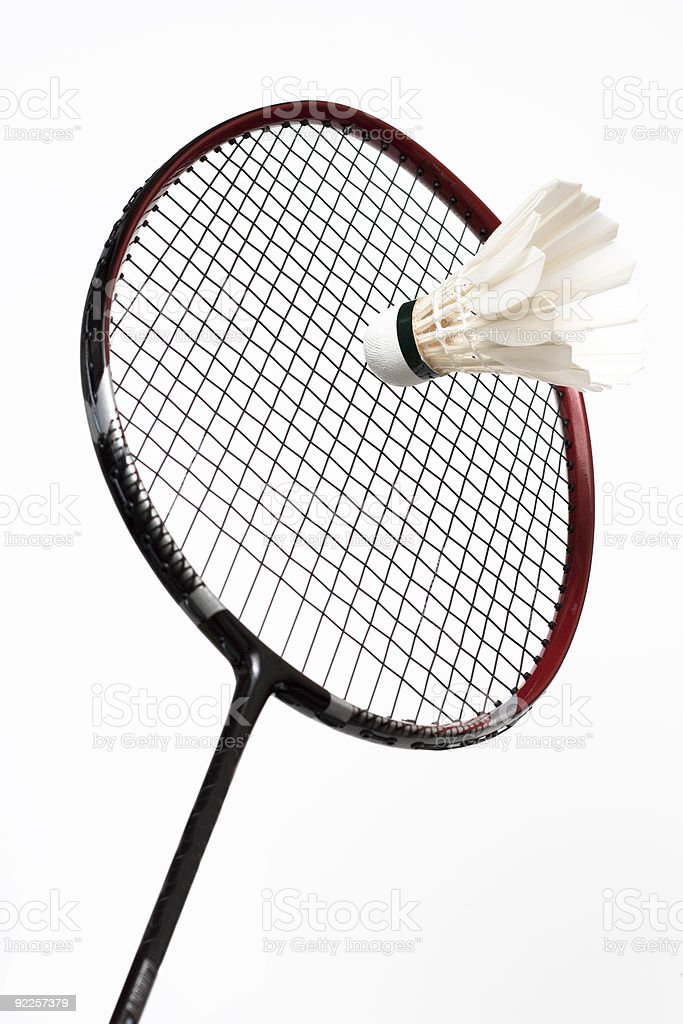 white shuttlecock and badminton racket royalty-free stock photo