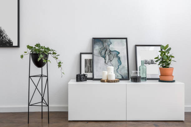 white sideboard and flower stand - sideboard imagens e fotografias de stock