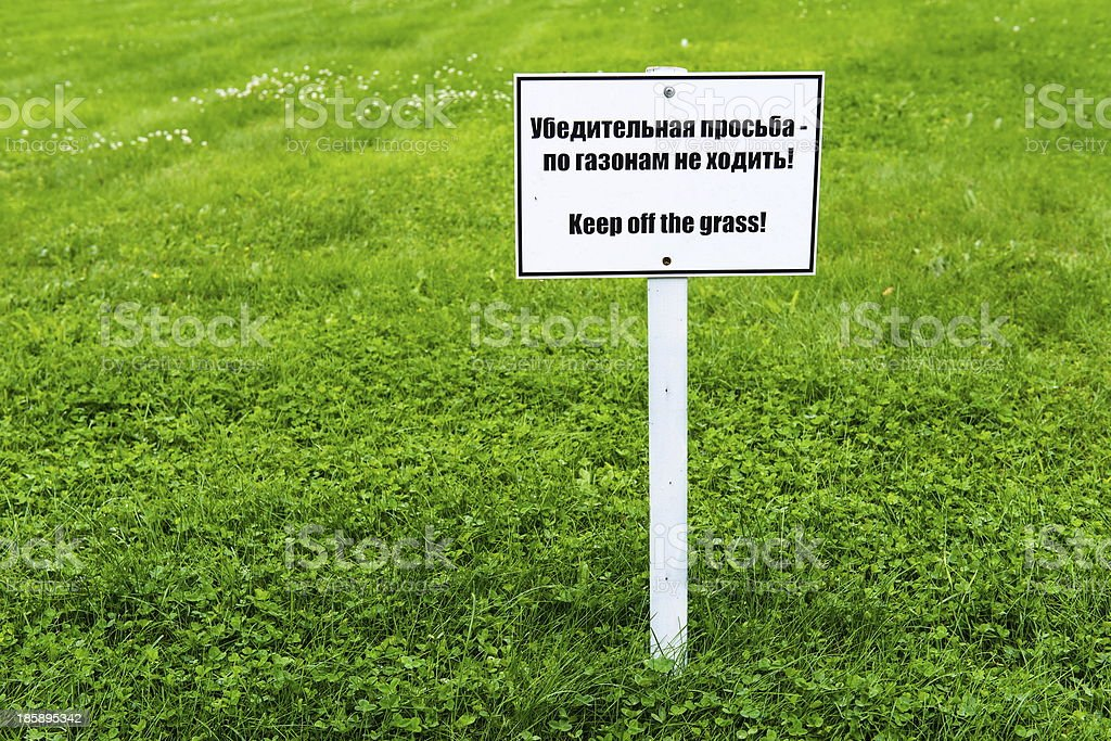 White sign board on green grass royalty-free stock photo