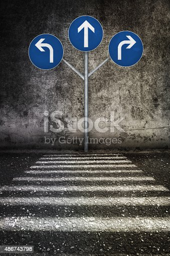 istock white sign way different directions at grunge wall 486743798