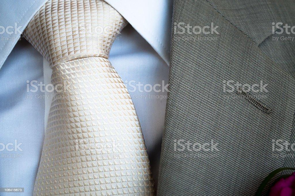 White silk tie with grey jacket lapel stock photo