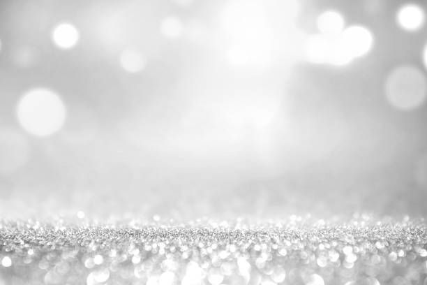White silver glitter and grey lights bokeh abstract background. stock photo