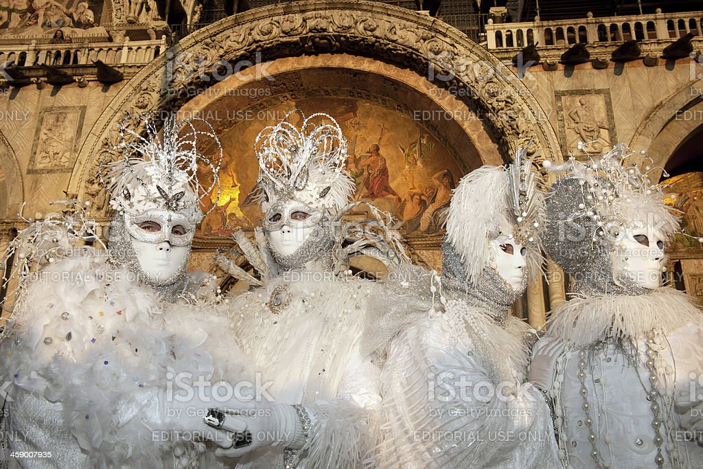 White Silver Masks and Basilica 2013 Carnival Venice Italy royalty-free stock photo