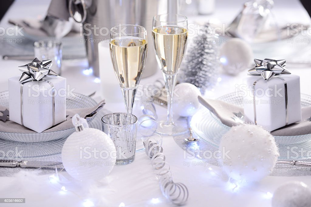 white silver new year eve christmas luxury restaurant table champagne stock photo