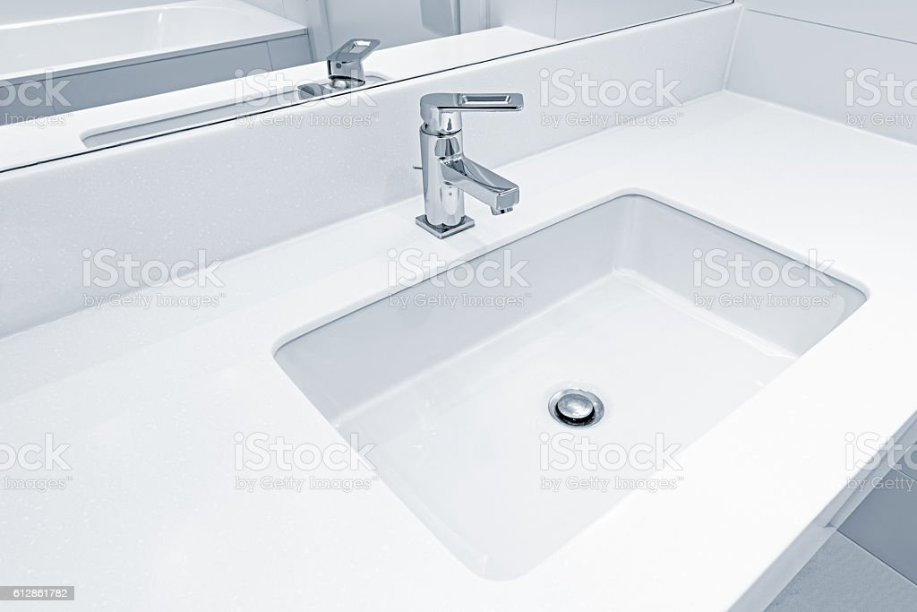 White sink by the mirror. stock photo