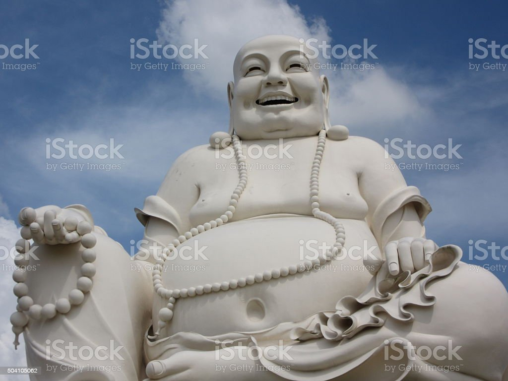 White Sitting Buddha Monument Against Blue Sky/Clouds stock photo