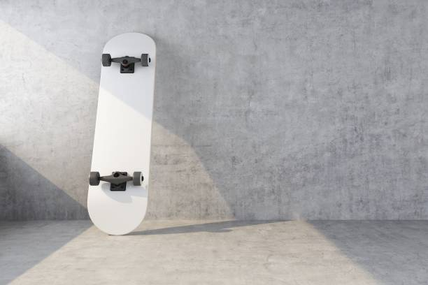 white skateboard on concrete wall background - skate foto e immagini stock