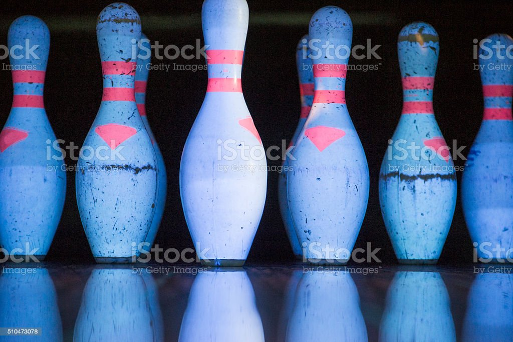 White skittles for bowling and their reflection stock photo