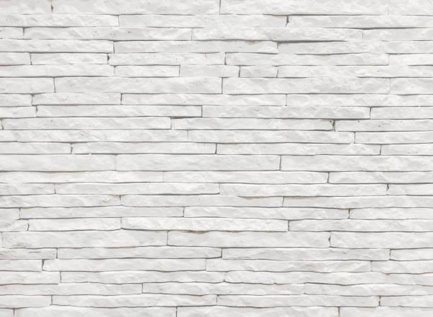 weißen schiefer steinmauer hintergrund - schiefer fliesen stock-fotos und bilder