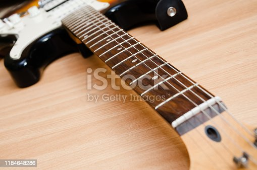 1014432572istockphoto white slip with sound pickups on an electric guitar. 1184648286