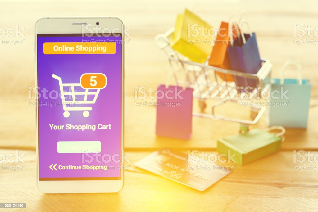 White smart device shows an online shopping screen app. stock photo