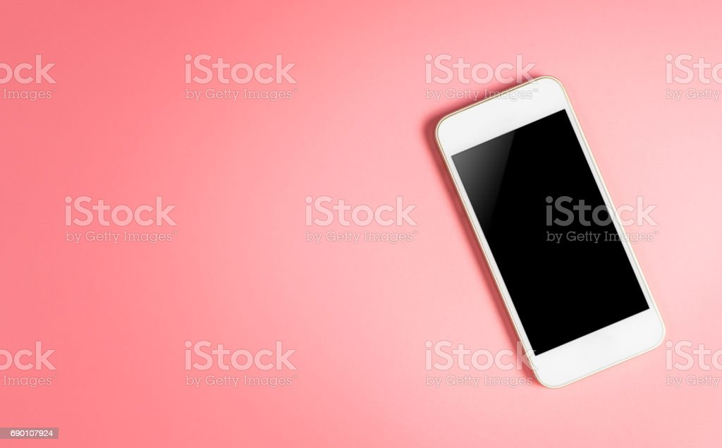 White smartphone and blank screen on pink copy space