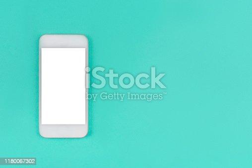 1161116588istockphoto White smartphone on mint background. 1180067302