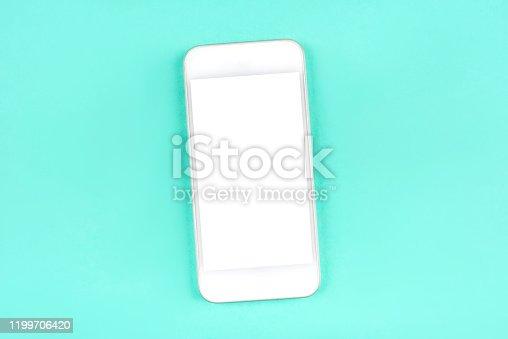 1161116588istockphoto White smartphone on mint background. 1199706420