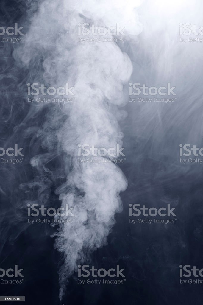 White smoke cloud with dark background and low light royalty-free stock photo