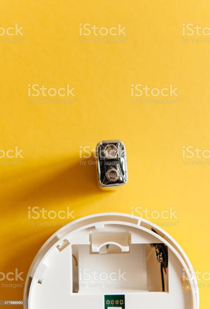 White smoke detector with nine volt battery bildbanksfoto