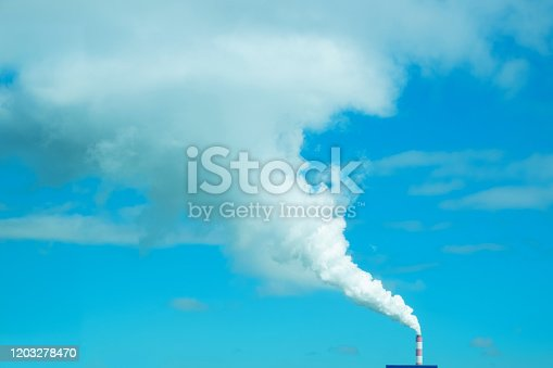 White smoke from chimney of factory
