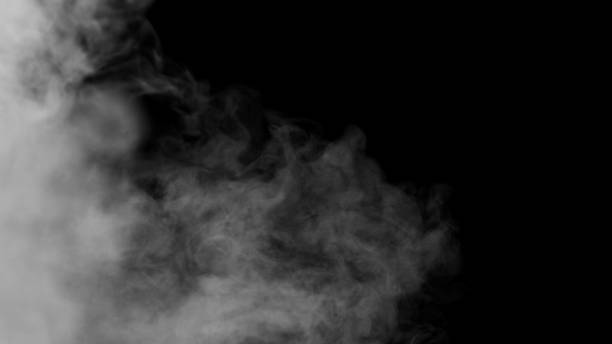 White Smoke on Black Background White clouds of vapor smoke are isolated on a black background. Gas explodes, swirl and dances in space. A magic fog dust texture effect that can be used by overlay and changing their transparency. smoke physical structure stock pictures, royalty-free photos & images