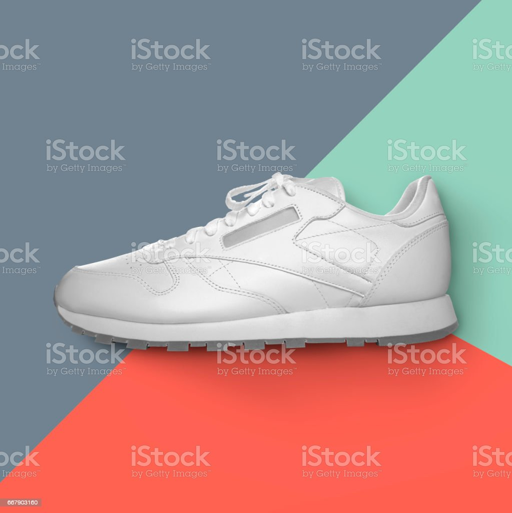 White sneakers and colorful background stock photo