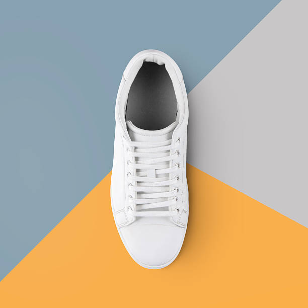 white sneakers and colorful background with clipping path - neue sneaker stock-fotos und bilder