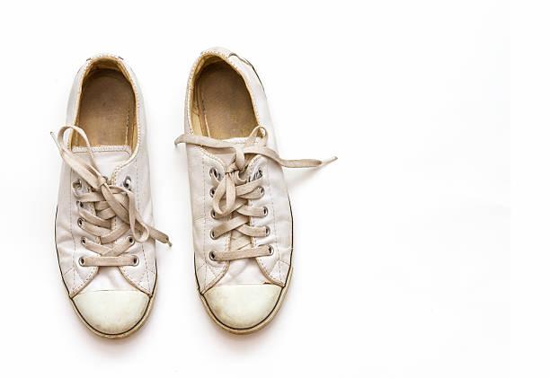 White sneakers on white background. stock photo