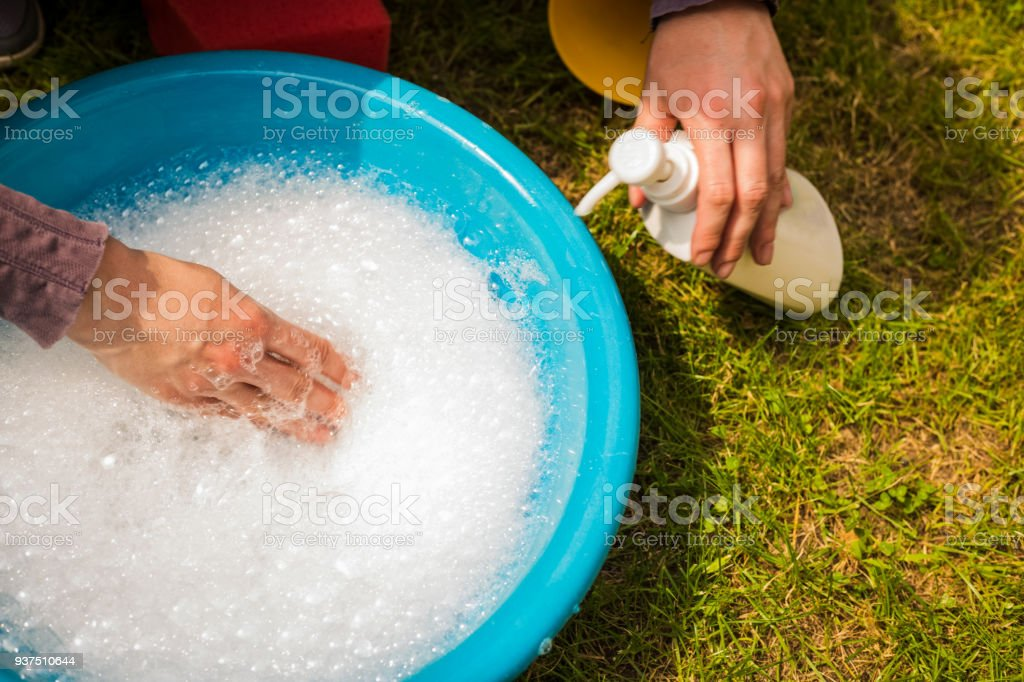 White Soap Bubbles Foam On Blue Tub Stock Photo & More Pictures of ...