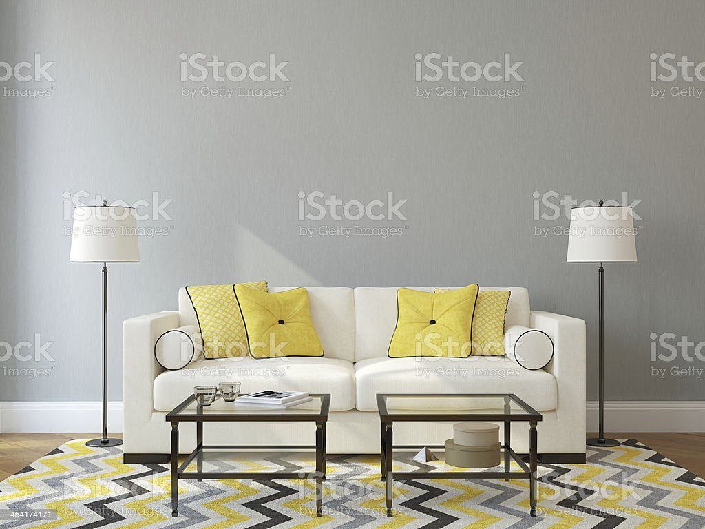 White sofa against gray wall with glass tables stock photo