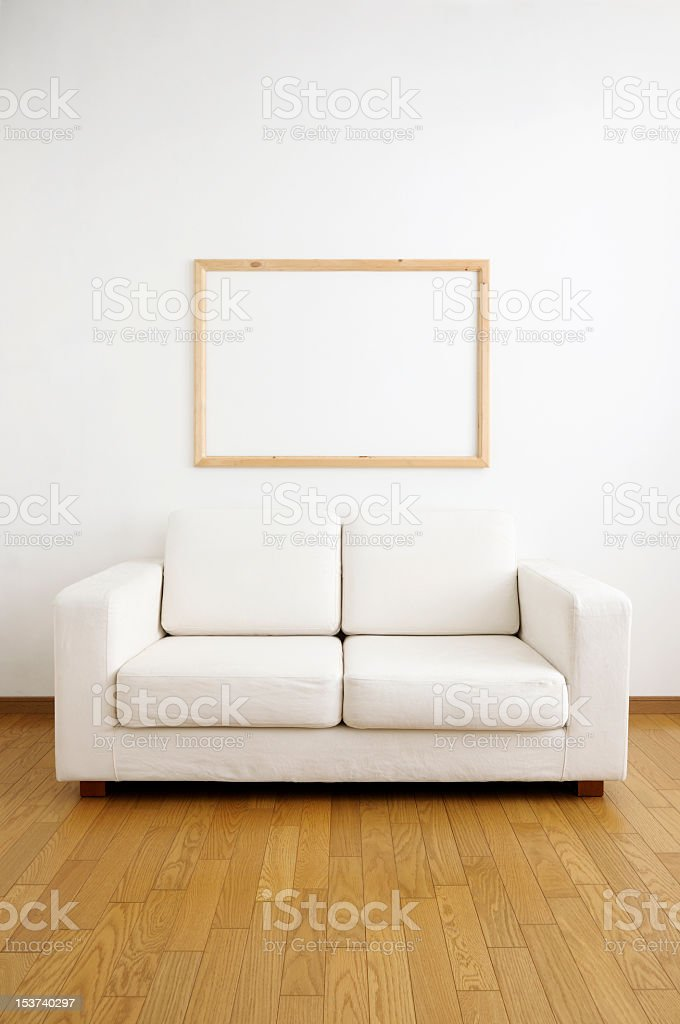 White sofa and blank frame on the wall royalty-free stock photo